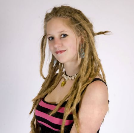 a pretty girl with dreads smiling at the camera photo