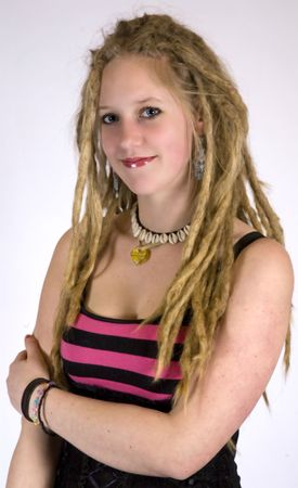 a pretty girl with dreads smiling at the camera