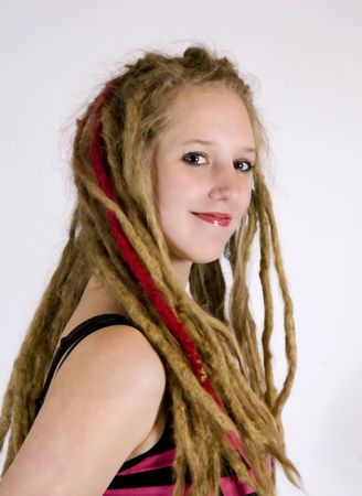 dreads: a pretty girl with dreads smiling at the camera