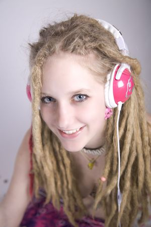 a pretty blond girl with dreads listening to music