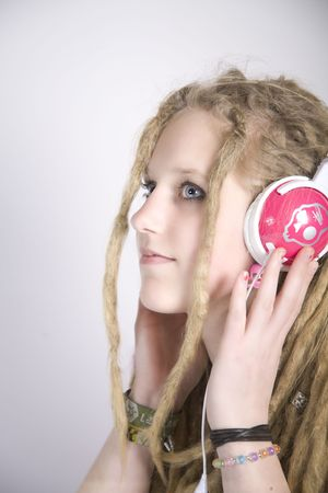 a pretty blond girl with dreads listening to music photo