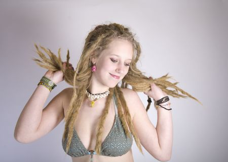 a pretty blond girl with dreads and a bikini top photo