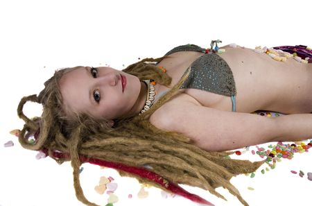a pretty blonde girl laying on the floor surrounded by candies Stock Photo