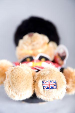 a cute teddybear dressed like a british royal guard