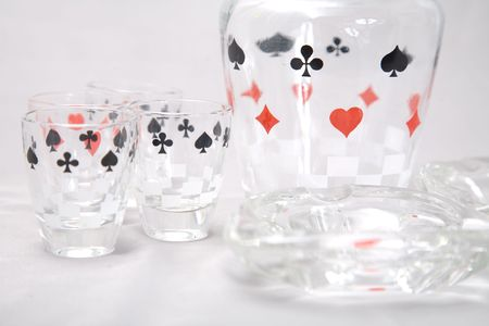 a set of shot glasses with pattern of cards Stock Photo