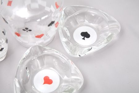 a set of glasses with pattern of cards