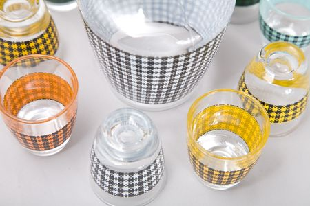a set of colorful shot glasses with colorful pattern
