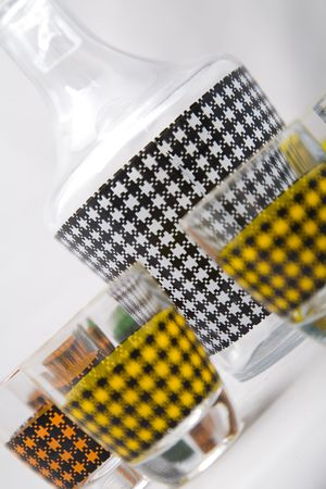 a setof shot glasses with colorful pattern