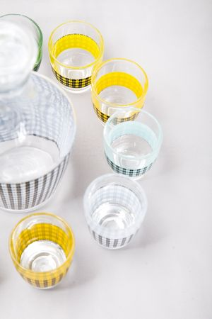 a set of shot glasses with colorful pattern