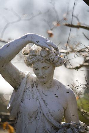 an old statue in a garden