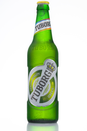dewed: MINSK, BELARUS-AUGUST 23, 2016. Tuborg glass bottle beer ion isolated white background. Editorial
