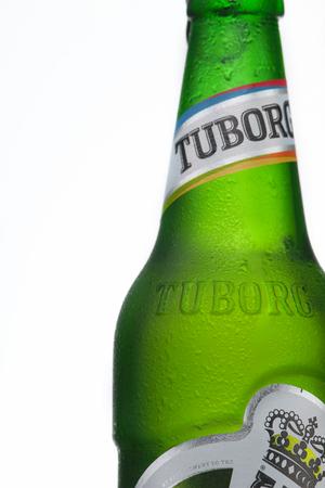 MINSK, BELARUS-AUGUST 23, 2016. Tuborg glass bottle beer ion isolated white background. Editorial