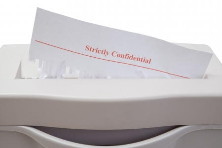 Shred of strictly confidential documents photo