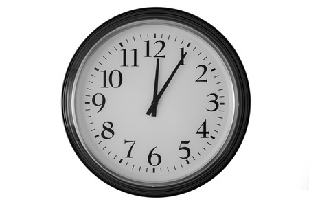 Big clock shows it is 5 after 12