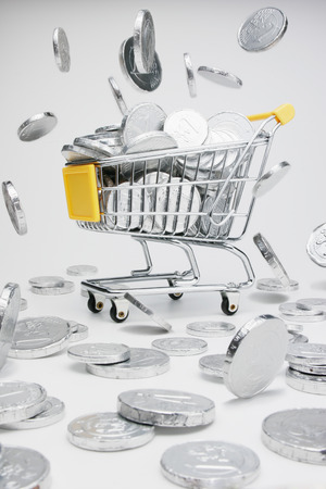 inflation basket: Shopping cart full of coins