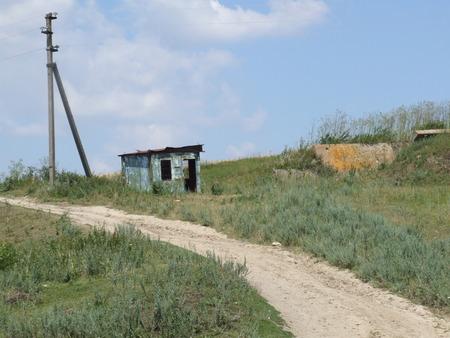Abandoned metal box near the field road