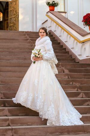 Newlyweds on high steps near the Orthodox Church