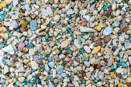 Sea pebbles. Pebble background. Wet stones. Multi-colored pebbles. Sea shore. Rocky texture from natural materials. Vacation, travel, building concept.