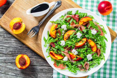peaches, arugula, prosciutto and goat cheese salad with balsamic vinegar