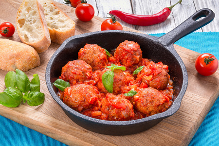 smothered: homemade meatballs smothered in a marinara tomato sauce with basil