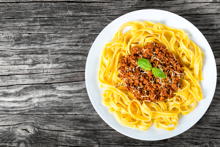 ragout: Bolognese ragout with italian pasta on a white plate, close-up