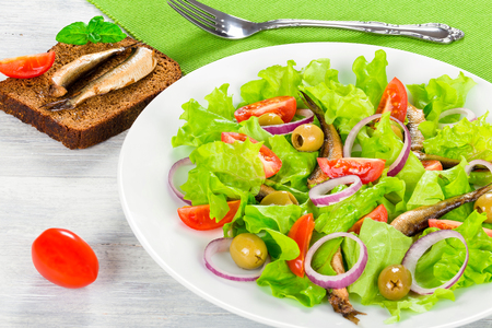 sprats: cherry tomatoes, red onion, green olives, lettuce leaves, smoked sprats