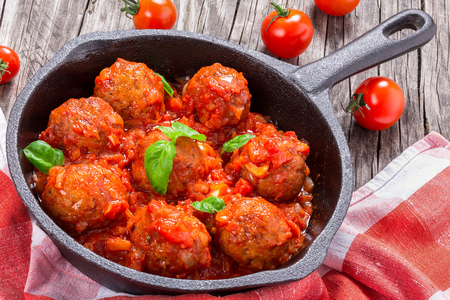 smothered: meatballs smothered in a tomato sauce with basil,garlic,spices