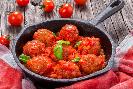 smothered: homemade meatballs smothered in a marinara tomato sauce, close-up Stock Photo