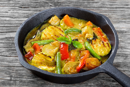 curry with vegetables stewed in a frying pan, close-up
