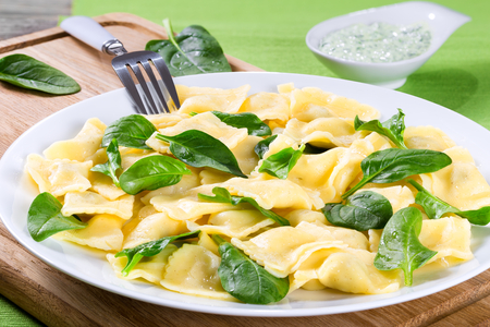 ricotta cheese: italian ravioli filling with  ricotta cheese and spinach, close-up