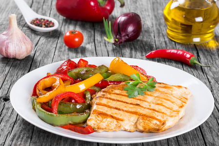 Delicious Grilled Chicken breast fillet and fried bell pepper , clos- up Banco de Imagens
