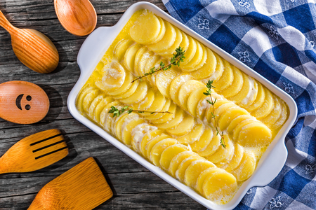 Au Gratin Dauphinois, Potatoes prepared for roasting in a pan Stock Photo