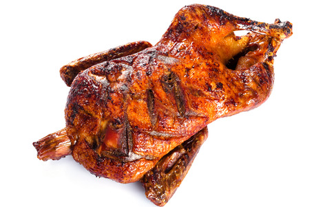 fryed: Roasted Whole Duck in honey mustard soy glaze on a white background, close-up