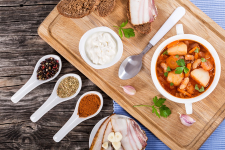 european cuisine: European cuisine. Ukrainian vegetable and meat soup borscht in a white wide rim dish, view from above Stock Photo