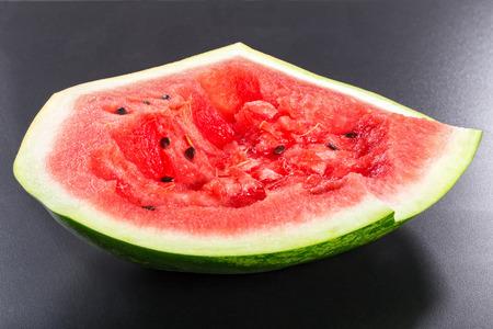 eaten: eaten watermelon  on a black background, side view Stock Photo