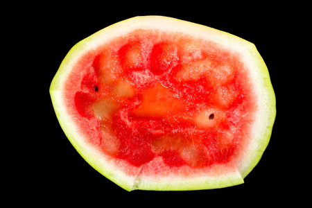 eaten: eaten watermelon isolated on a black background, top view