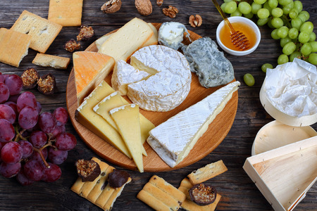 set of authentic french Cheeses served with grapes honey homemade chocolate sweets and nuts & Set Of Authentic French Cheese Plate Served With Grapes Honey ...