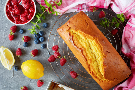 delicious lemon cake or pound cake with berries filling also known as gateau de voyage cake, french cuisine, view from above, close-up, flat lay
