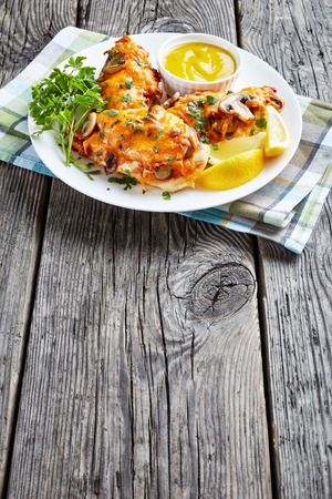Aussie Chicken breasts topped with melted cheese