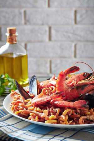 Close-up of Spanish Fideua, a noodle Paella with king prawns
