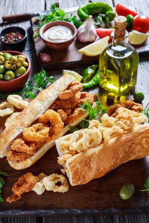 sandwiches with calamari ringss, Bocadillos De Calamares, fresh bread roll filled with squid rings that have been coated in flour and in breadcrumbs and deep-fried in olive oil, spanish cuisine Stock fotó