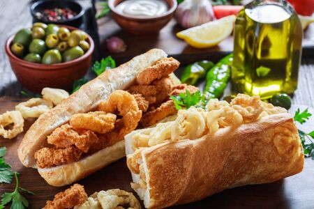 sandwiches with calamari ringss, Bocadillos De Calamares, fresh bread roll filled with squid rings that have been coated in flour and in breadcrumbs and deep-fried in olive oil, spanish cuisine 写真素材