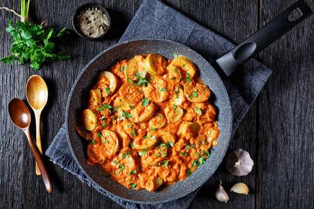 zucchini braised in a creamy tomato sauce, italian cuisine, flat lay