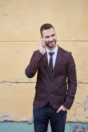 suave: Smiling business man standing outside office building