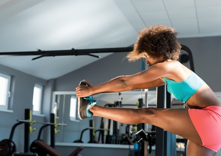 african american woman: African American woman training in gym