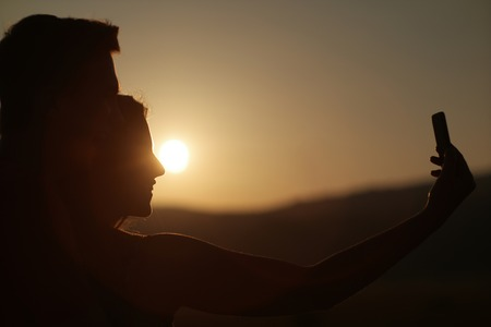 love pic: Couple of best friends taking selfie during sunset. Modern concept of friendship with new trends and technology - Travel girlfriends having emotional fun together Stock Photo