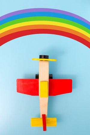 babyroom: wooden aeroplane toy and rainbow