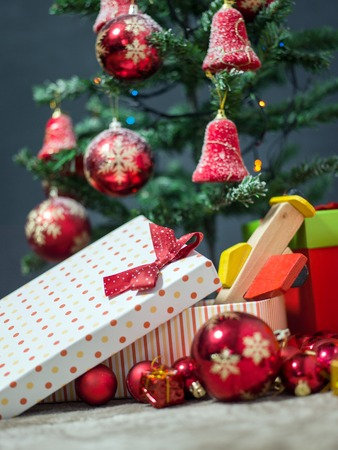 christmastime: gift boxes under Christmas tree, Christmastime surprises, New Year eve concept