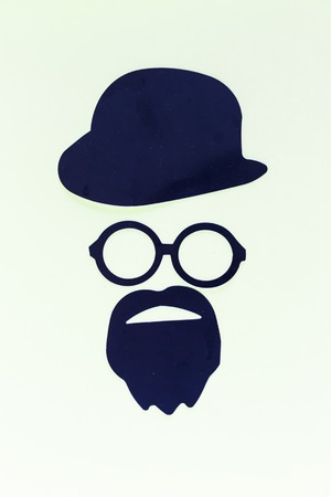 paper cutout: man with beard or mustages paper cutout, detective or hipster