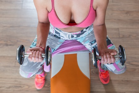 Girl with dumbbells in the gym Stock Photo